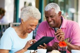Senior couple using a template computer 1
